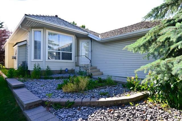 124 Harvest Park Way NE, Calgary, AB T3K 4K7 (#A1018692) :: Redline Real Estate Group Inc