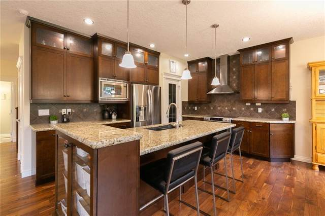 230 Valley Woods Place NW, Calgary, AB T3B 6A3 (#A1018996) :: Redline Real Estate Group Inc