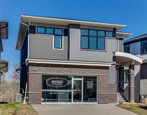 9 Rock Lake Heights NW, Calgary, AB T3G 0G1 (#A1019876) :: Redline Real Estate Group Inc