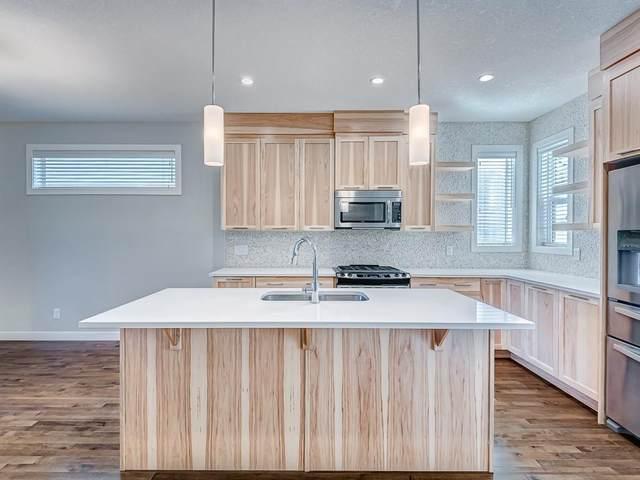 206 Copperpond Boulevard SE, Calgary, AB T2Z 0X3 (#A1020530) :: Redline Real Estate Group Inc