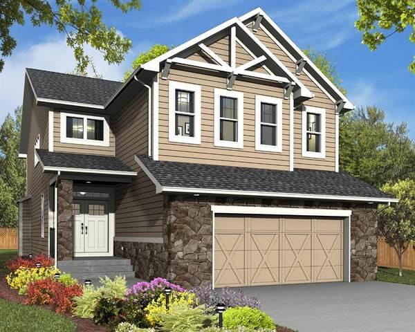 30 Coach Ridge Point SW, Calgary, AB T3H 2A7 (#A1021082) :: Redline Real Estate Group Inc