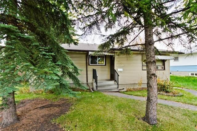 116 Lissington Drive SW, Calgary, AB T3E 5E3 (#A1025531) :: Redline Real Estate Group Inc
