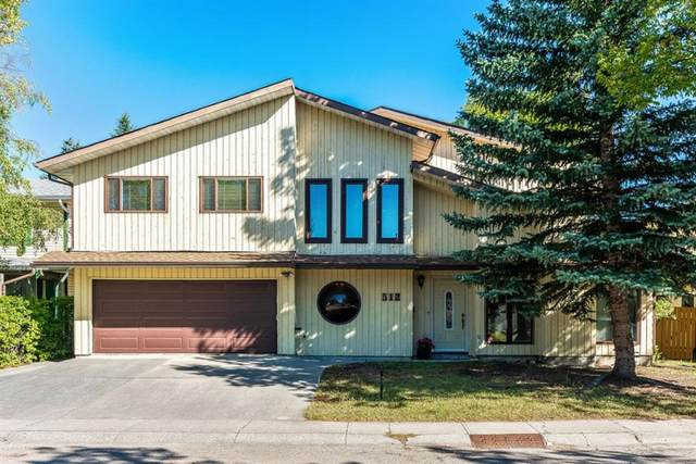 512 Woodpark Crescent SW, Calgary, AB T2W 2S2 (#A1025977) :: Redline Real Estate Group Inc