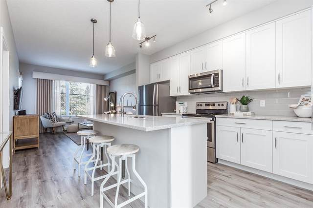 71 Shawnee Common SW #106, Calgary, AB T2Y 0R2 (#A1027788) :: Western Elite Real Estate Group