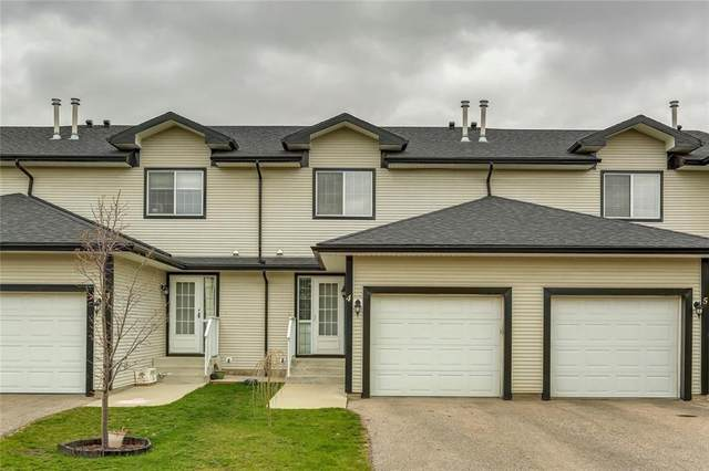 12 Silver Creek Boulevard NW #4, Airdrie, AB T4B 2R2 (#A1029688) :: Canmore & Banff