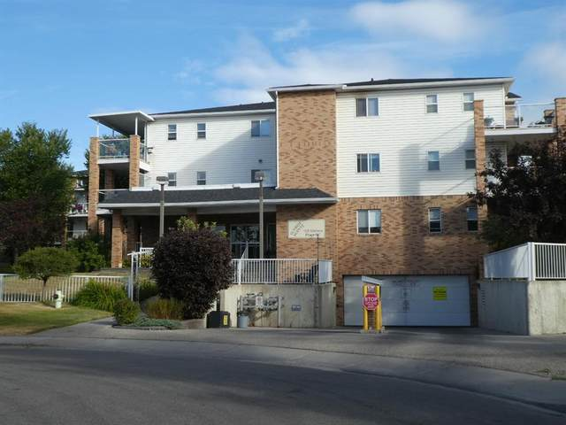 165 Manora Place NE #127, Calgary, AB  (#A1030344) :: Canmore & Banff