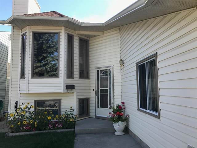 10 Sandringham Way NW, Calgary, AB T3K 3V5 (#A1030495) :: Canmore & Banff