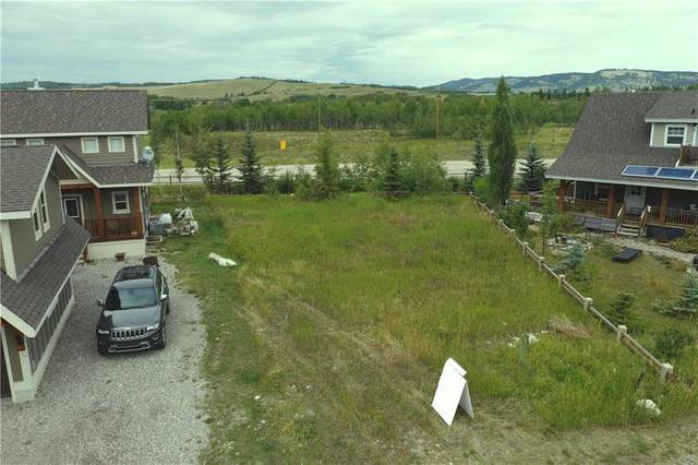 216 Cottageclub Crescent, Rural Rocky View County, AB T4C 1C3 (#A1032213) :: Redline Real Estate Group Inc