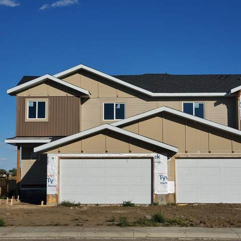 1230 Westmount Drive, Strathmore, AB T1P 1Y9 (#A1032390) :: Canmore & Banff