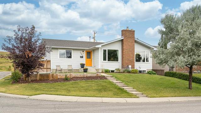 1203 57 Avenue NW, Calgary, AB T2K 5P9 (#A1032489) :: Calgary Homefinders