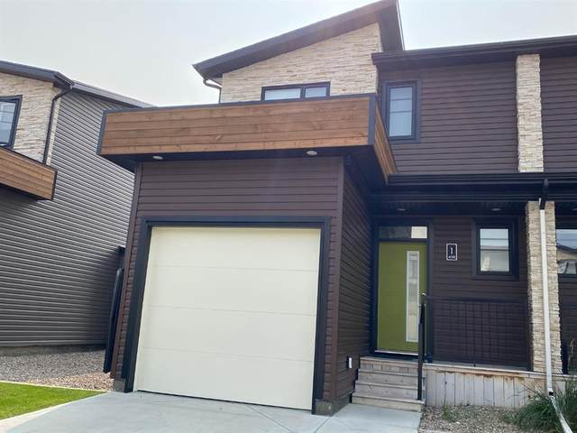 458 Highlands Boulevard W #1, Lethbridge, AB T1J 0B8 (#A1034408) :: Canmore & Banff