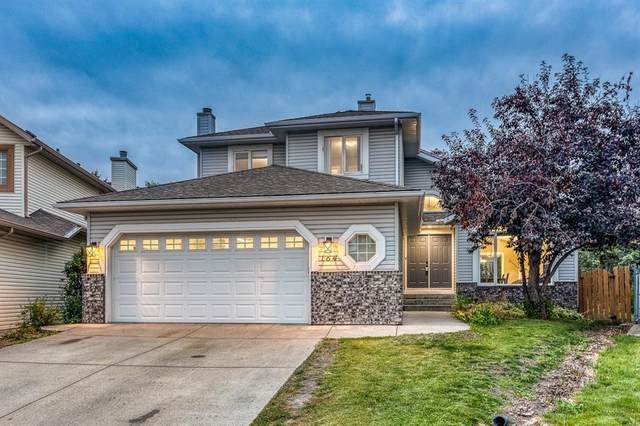 164 Woodstock Way SW, Calgary, AB T2W 6G1 (#A1034779) :: Redline Real Estate Group Inc