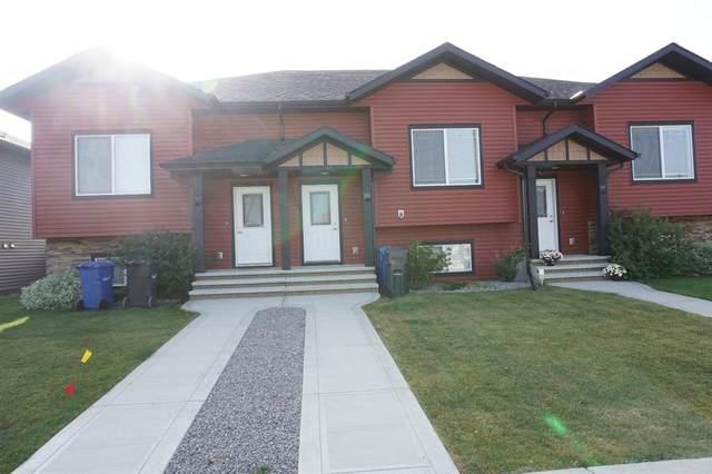 103 Hawkridge Boulevard, Penhold, AB T0M 1R0 (#A1034900) :: Canmore & Banff