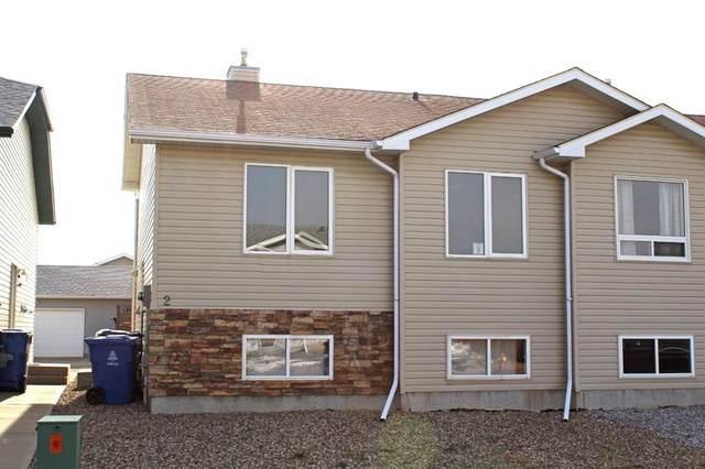 720 Heritage Boulevard W #2, Lethbridge, AB T1K 7X2 (#A1036255) :: Calgary Homefinders
