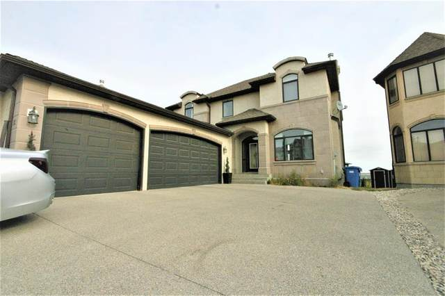 36 Coulee Park SW, Calgary, AB T3H 5J6 (#A1036278) :: Western Elite Real Estate Group
