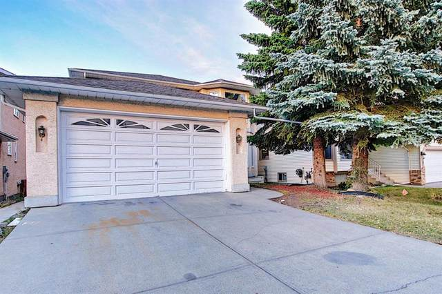 36 Sandringham Close NW, Calgary, AB T3K 3X1 (#A1037276) :: Canmore & Banff