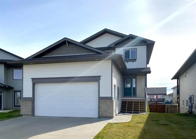 11213 80 Avenue, Grande Prairie, AB T8W 0B7 (#A1037395) :: Canmore & Banff