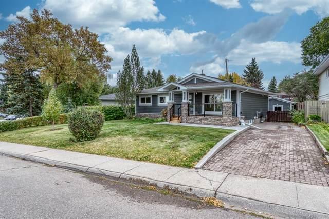 89 Woodlark Drive SW, Calgary, AB T3C 3H6 (#A1037449) :: Calgary Homefinders