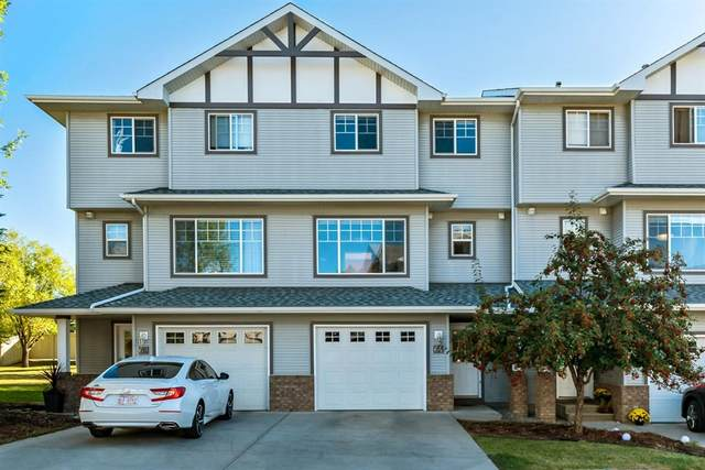 64 Crystal Shores Cove, Okotoks, AB T1S 2B4 (#A1037706) :: Canmore & Banff