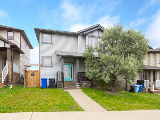 221 Sparrow Hawk Drive, Fort Mcmurray, AB T9K 0R6 (#A1037898) :: Canmore & Banff