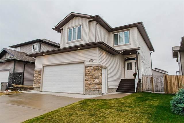 11529 73 Avenue, Grande Prairie, AB T8W 0J5 (#A1037904) :: Canmore & Banff