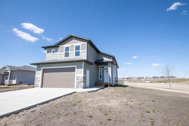 10402 129 Avenue, Grande Prairie, AB T8V 6J5 (#A1037957) :: Canmore & Banff