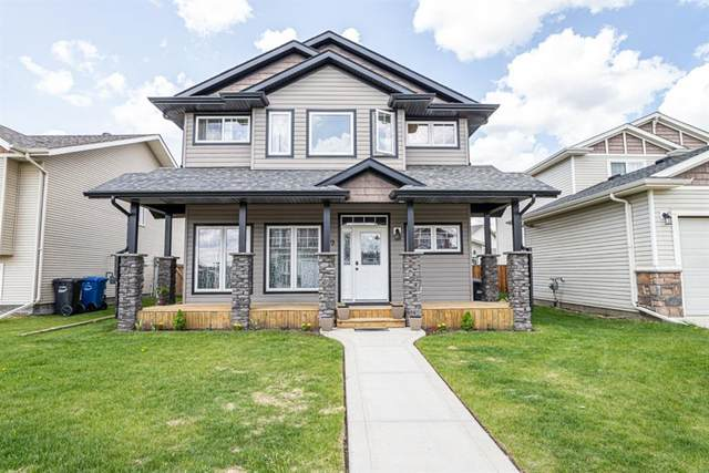 99 Heartland Crescent, Penhold, AB T0M 1R0 (#A1038794) :: Canmore & Banff