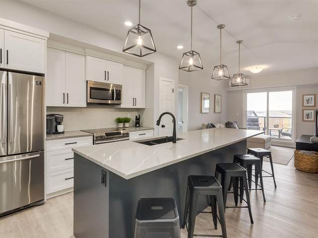 4150 Seton Drive SE #401, Calgary, AB T3M 3C7 (#A1040306) :: Western Elite Real Estate Group