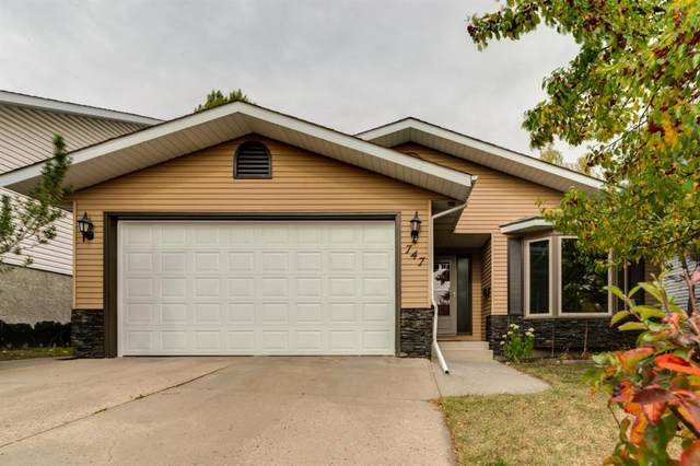 747 Strathcona Drive SW, Calgary, AB T3H 1P2 (#A1041026) :: Canmore & Banff