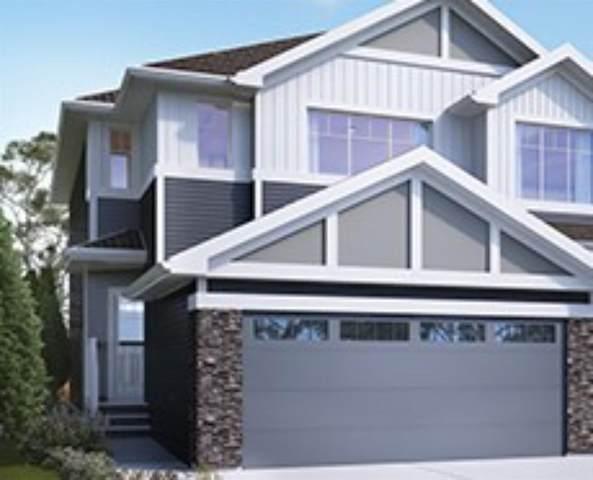 135 Heartland Street, Cochrane, AB  (#A1041220) :: Canmore & Banff