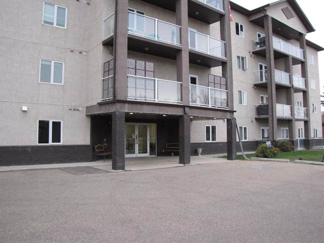 5205 Woodland Road #305, Innisfail, AB T4G 0B2 (#A1041445) :: Canmore & Banff