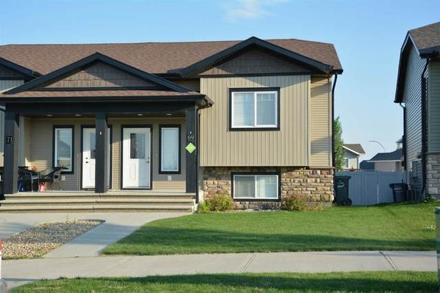 69 Hawkridge Boulevard, Penhold, AB T0M 1R0 (#A1041593) :: Canmore & Banff