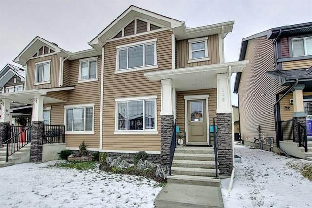 105 Heartland Boulevard, Cochrane, AB T4C 2R1 (#A1042872) :: Canmore & Banff