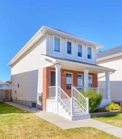 7951 Wentworth Drive SW, Calgary, AB T3H 4P2 (#A1043089) :: Canmore & Banff