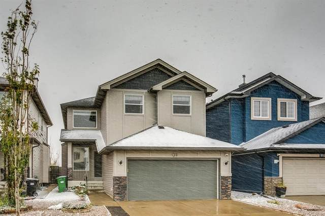 59 Saddlecrest Terrace, Calgary, AB T3J 5L4 (#A1043132) :: Canmore & Banff