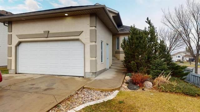 12201 Crystal Lake Drive, Grande Prairie, AB T8X 1M8 (#A1043913) :: Canmore & Banff
