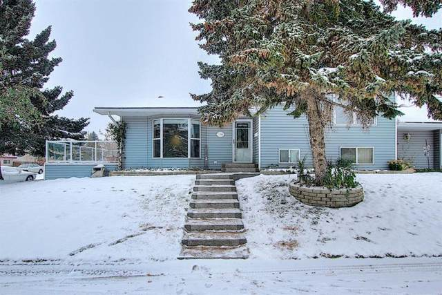 284 Woodside Circle SW, Calgary, AB T2W 3K5 (#A1043943) :: Canmore & Banff