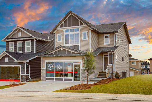7 Heritage Heights, Cochrane, AB T4C 2R4 (#A1044394) :: Canmore & Banff