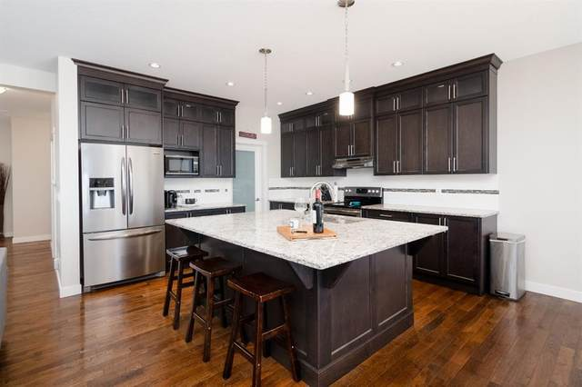 126 Reunion Green NW, Airdrie, AB T4B 3X1 (#A1044885) :: Canmore & Banff