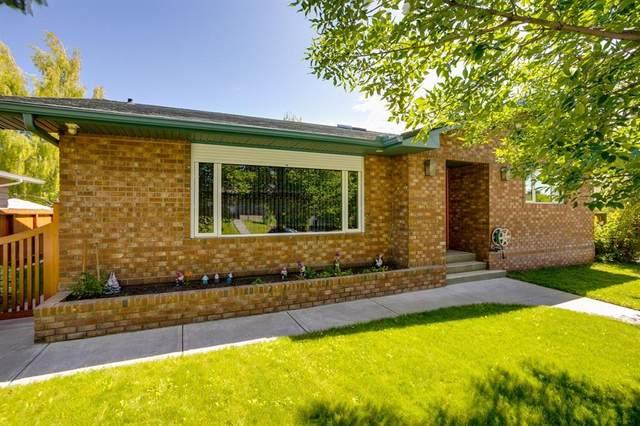108 Parkland Hill SE, Calgary, AB T2J 4K6 (#A1045444) :: Canmore & Banff