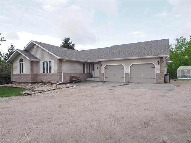 5208 Woodland Road, Innisfail, AB T4G 1E3 (#A1045602) :: Canmore & Banff