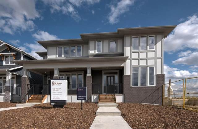 120 Creekside Drive SW, Calgary, AB T2X 4A8 (#A1048904) :: Canmore & Banff