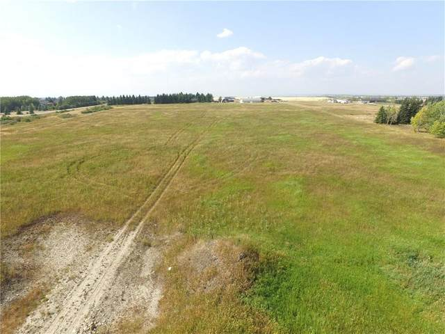 32230 Willow Way, Rural Rocky View County, AB T4C 1A2 (#A1049047) :: Redline Real Estate Group Inc