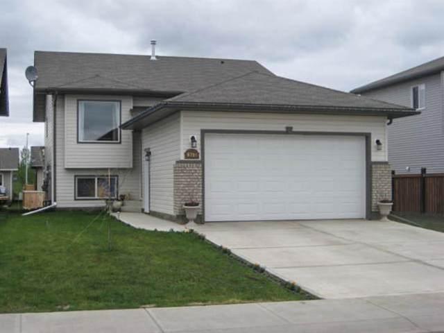 8718 64 Avenue, Grande Prairie, AB T8W 0A5 (#A1049816) :: Canmore & Banff
