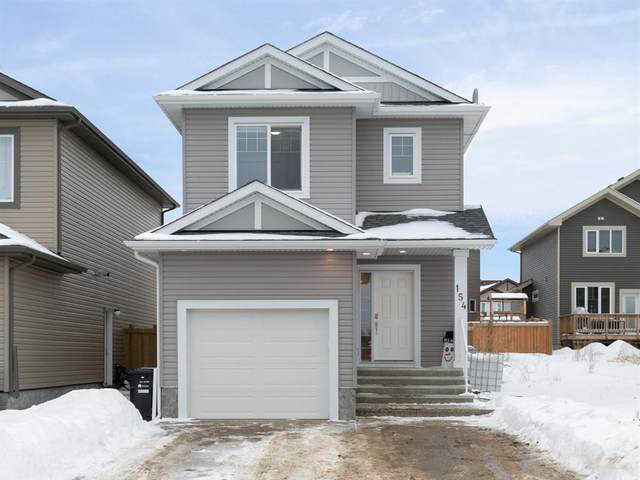 154 Athabascas Crescent, Fort Mcmurray, AB T9V 1C4 (#A1061104) :: Canmore & Banff