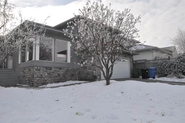 100 Straddock Crescent SW, Calgary, AB T3H 2T1 (#A1063313) :: Western Elite Real Estate Group