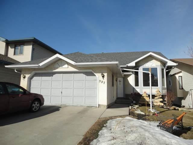 327 Sandalwood Close NW, Calgary, AB T3K 4B3 (#A1076719) :: Greater Calgary Real Estate