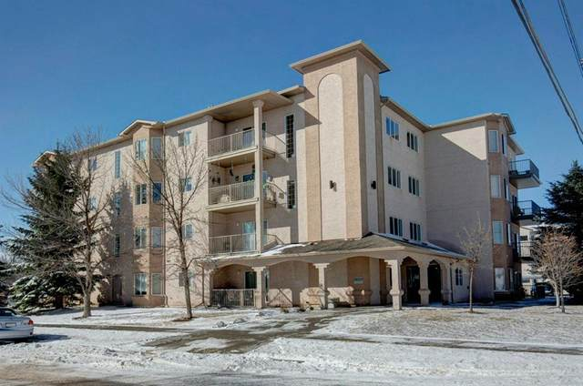 16 Poplar Avenue #104, Okotoks, AB T1S 1Z4 (#A1086415) :: Redline Real Estate Group Inc
