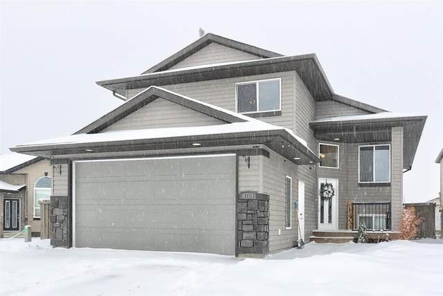 8709 63 Avenue, Grande Prairie, AB T8W 0A5 (#A1086422) :: Redline Real Estate Group Inc