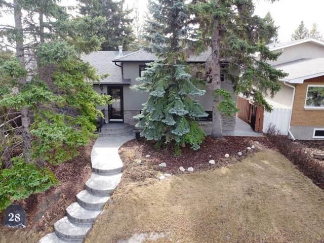 28 Glacier Place SW, Calgary, AB T3E 5A4 (#A1091436) :: Redline Real Estate Group Inc
